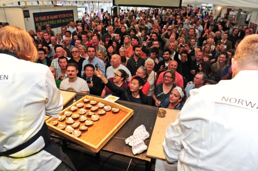 Crowds gather for the oyster opening competition at The Galway Oyster Festival on Saturday. Photo: Boyd Challenger