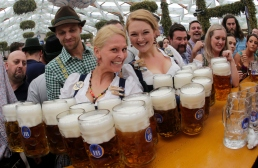 Waitresses Beli, right, and Anika pose with beer mugs during the opening of the 181th Oktoberfest beer festival in Munich, southern Germany, Saturday, Sept. 20, 2014. The world's largest beer festival will be held from Sept. 20 to Oct. 5, 2014. (AP Photo/Matthias Schrader) ORG XMIT: MAS122