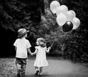 holding-hand-kids-little-couple-balloon-cute-300x262